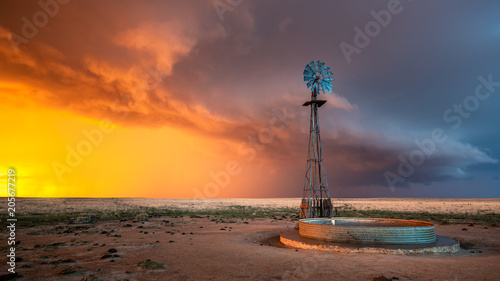 Fotografie, Obraz  Windmill in a Thunderstorm at Sunset