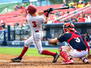 baseball player hitting and sliding