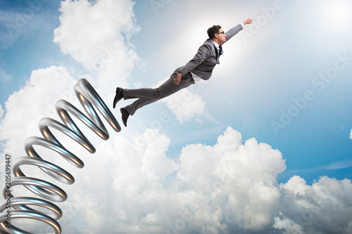 Businessman jumping from spring in promotion concept Slika na platnu