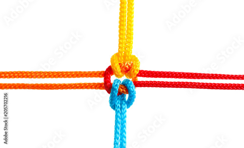 Obraz Colorful ropes tied together on white background. Unity concept - fototapety do salonu