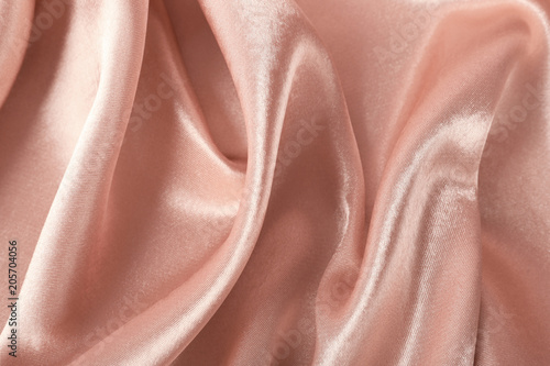 Texture of rose gold silk as background, closeup