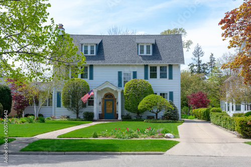 Front view of traditional colonial home with blue shutters Canvas Print