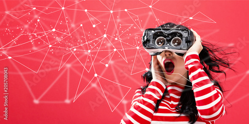 Fotografie, Obraz  Links with young woman using a virtual reality headset