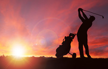 Golfer Silhouette During Sunse...