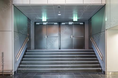 Fire exit metallic doors with staircase Fototapeta