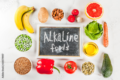Photo Healthy food background, trendy Alkaline diet products - fruits, vegetables, cereals, nuts