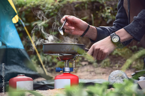 Tuinposter Kamperen Breakfast in front of the tent in the morning,defocus background