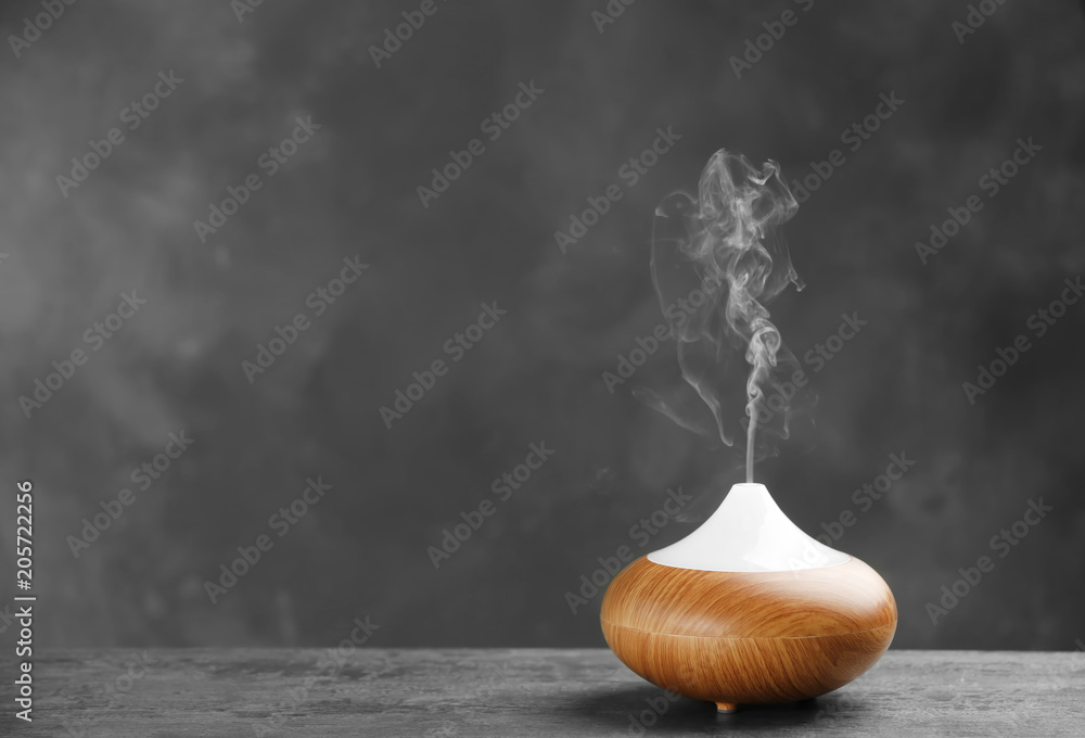Fototapety, obrazy: Aroma oil diffuser on table against grey background. Air freshener