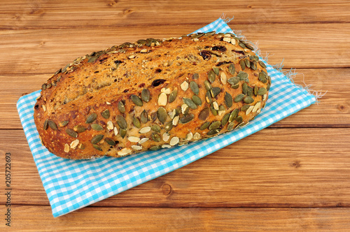 Rustic Pumpkin Seed Covered Crusty Bloomer Loaf On A Wooden Background