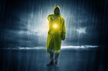 Raincoated Man Walking In Stor...
