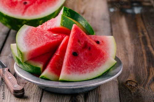Fresh sliced watermelon on wooden rustic background