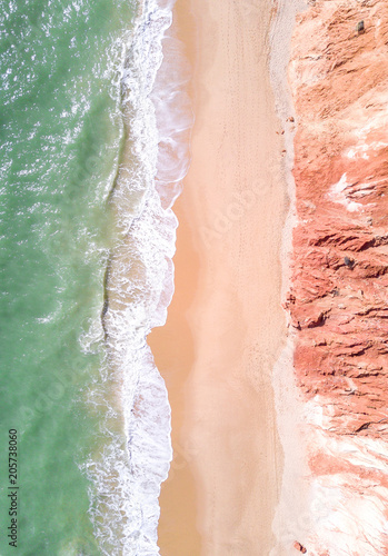 Wall Murals Air photo Aerial view of tropical sandy beach and ocean with turquoise water.