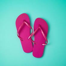 Pink Flip Flops Over Blue Back...
