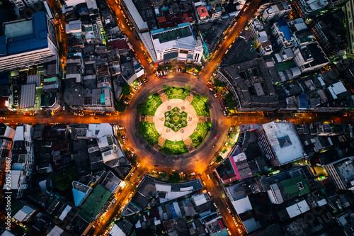 Fotografie, Obraz  Aerial view of roundabout or circle of road with light trails on the road at night in Bangkok,Thailand