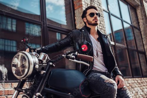 Fotografía  Biker with modern motorcycle