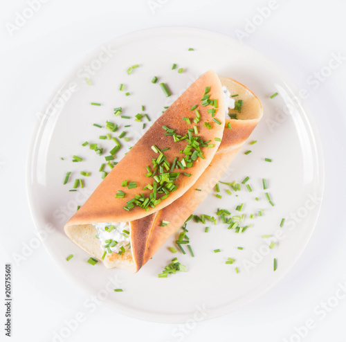 Foto op Canvas Klaar gerecht Pancake with cottage cheese and chives decorated with basil