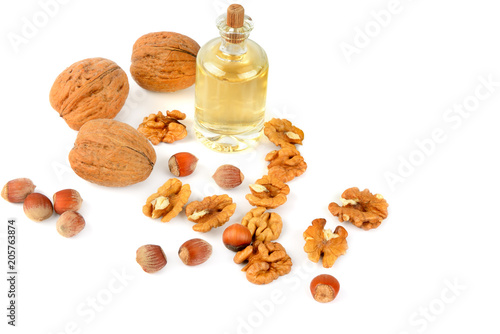 Staande foto Kruiderij Oil of walnut and hazelnut, nuts isolated on white background.