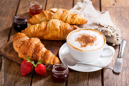 Breakfast with cup of cappuccino coffee with croissants
