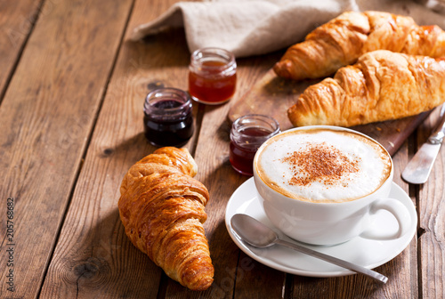 Breakfast with cup of cappuccino coffee with croissants Fototapeta