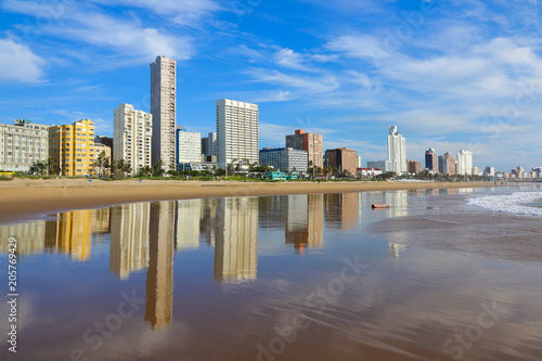 Fotografie, Obraz  Reflection of Durban Golden Mile beachfront in the Indian Ocean, KwaZulu-Natal