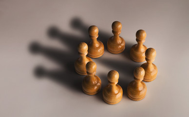 Chess pawn circle with shadow shaped as crown