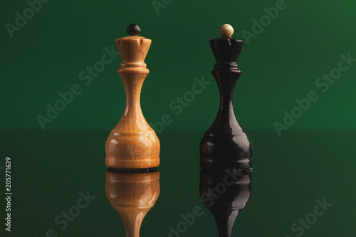Photo  Pair of queen chess pieces confronted as opposites
