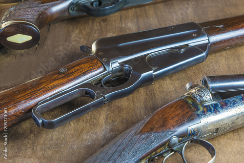 Fotobehang Jacht Beautiful hunting gun on wooden background close up, selective focus