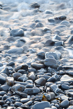 Pebbles On A Retreating Wave