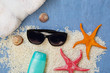 Sunglasses, starfish and seashells on the sand. Summer vacation concept