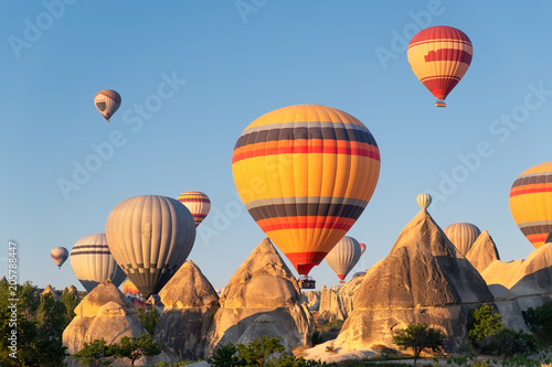 Airballons adove high rock. Beautiful natural landscape  at the summer time