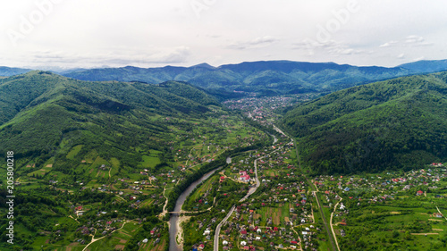 Tuinposter Luchtfoto Aerial view of Carpathian mountains in summer. Village in the mountains.