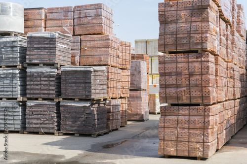 Valokuva  pallets with bricks in the building store
