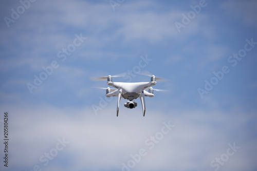 Dron flying free. Camera, radio. Poster