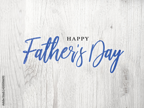 Fotografía  Happy Father's Day Blue Calligraphy Script Over White Wood Texture Background