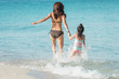 Mother And Daughter Walking and run On Beautiful Beach