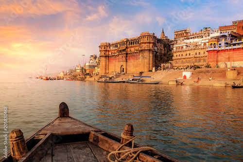 Stampa su Tela  Varanasi ancient city architecture at sunset as viewed from a boat on river Ganges
