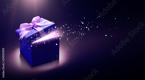 Photo  Blue open gift box with magical light