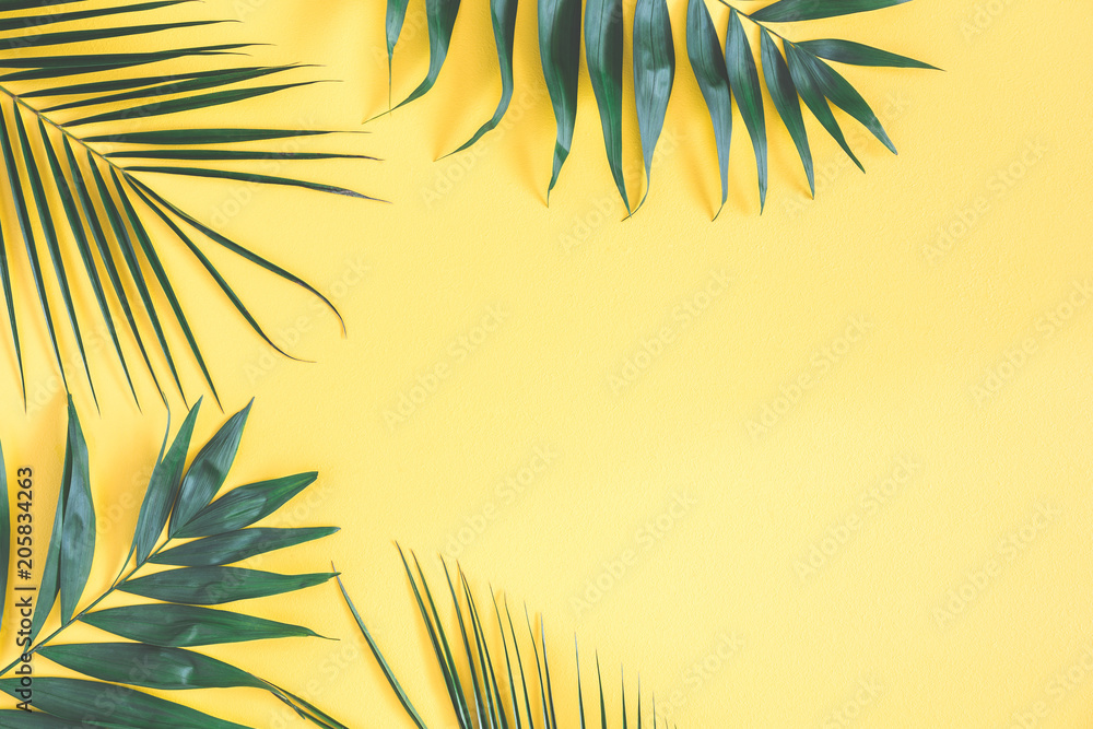 Fototapety, obrazy: Tropical palm leaves on yellow background. Summer concept. Flat lay, top view, copy space