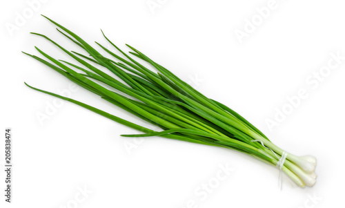 Bunch of the peeled green onion on a white background
