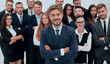 smiling businessman standing on background of her business team.