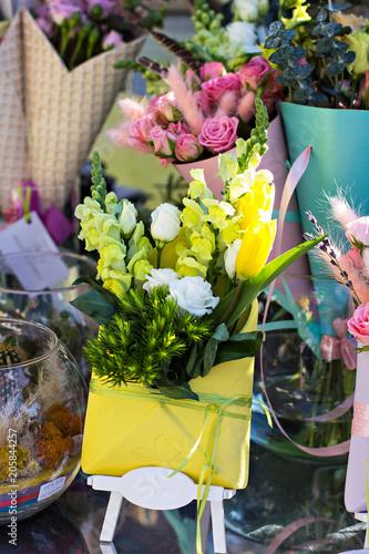 Foto op Canvas Bloemen Beautiful bouquets of flowers on the market. Showcase with flowers. Sale of flowers. Flower shop.