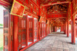 Red wooden hallway in the Purple Forbidden City, Hue, Vietnam