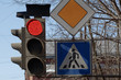 red traffic lights and road signs