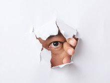 Hole Torn In Paper With The Ey...