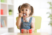 Cute Little Child Girl Eating ...