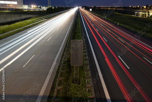 Spoed Foto op Canvas Nacht snelweg Gorgeous long exposure view at a highway A14 (Autobahn) in Leipzig, Germany