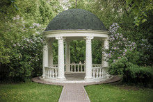 Beautiful White Gazebo In A Blooming Spring Park