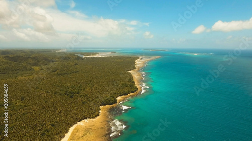 Keuken foto achterwand Tropical strand Aerial view of tropical beach on the island Siargao, Philippines. Beautiful tropical island with sand beach, palm trees. Tropical landscape: beach with palm trees. Seascape: Ocean, sky, sea