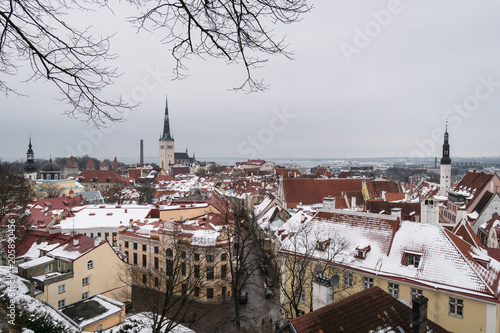 Aerial view of the medieval Tallinn old town and the Saint Olag church in Estonia capital city in winter by the Baltic sea in North East Europe
