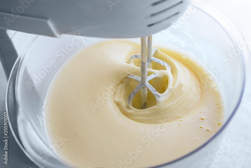 Fotografie, Obraz  mix biscuit dough with a electric mixer
